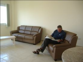 Sitting room with two leather sofas, included in sale