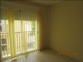 bedroom on second floor showing patio window and balcony
