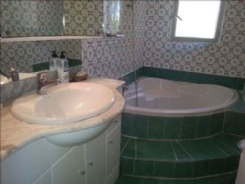 Bathroom with corner bath and mixer shower