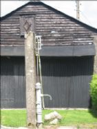 The old barn and water pump in the garden