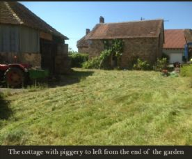 The cottage with piggery to the left from the rear of the garden