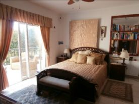 Master bedroom with private balcony overlooking pool