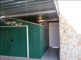 Large metal shed under car-port, rear of property