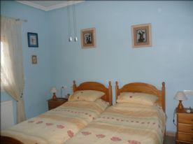 Third double bedroom overlooking rear garden with radiator