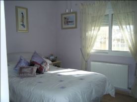 Main double bedroom, radiator & window to the front