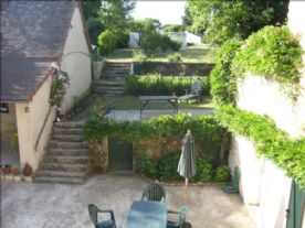 Courtyard and steps leading to garden