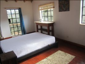 bedroom with balcony over looking the court yard, and down to the valley