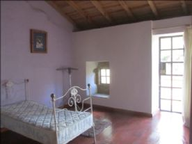 bedroom with balcony over looking the court yard, and down to the valley..