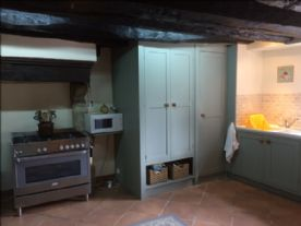 Kitchen view showing kitchen cupboards and sink