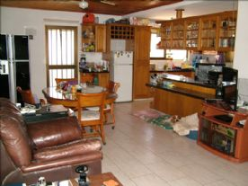 Dining room/Kitchen in background