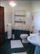 large bathroom with bidet and shower