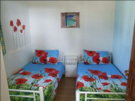 Bedroom 2 with 2 full size single beds