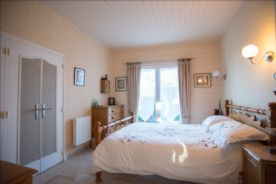 Bedroom 1 with two double fitted wardrobes & D/G  French doors