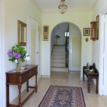 Marble floors greet visitors to our home - repainted to vanilla
