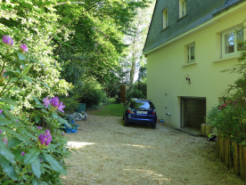 Private driveway from the chemin with parking for boats, caravans, more cars in garage.