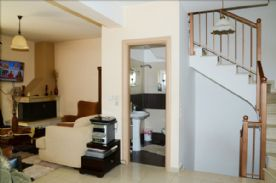 Mid-level showing cloakroom & up & down stairs