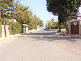 view from villa to beach at the end of the road