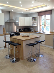 new kitchen, lighting and travertine floor tiles throughout installed 2021