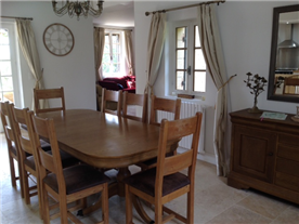 dining room through to lounge, showing front doors left