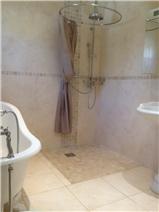 Bathroom with rainshower adjacent to bedroom main living level