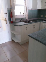 Kitchen with access to utility room