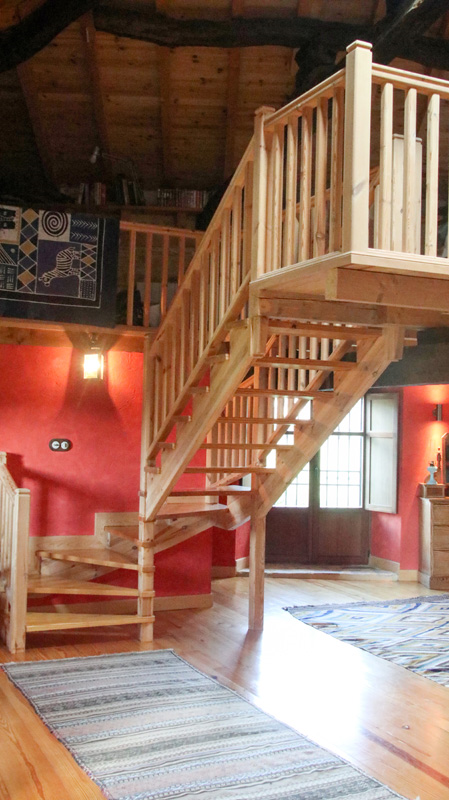 Stairs to seating/study/dining/kitchen in main suite