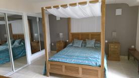 Master bedroom, triple mirrored wardrobes, new tiled floor view of side garden from window.
