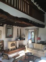 Many beamed sitting room with Godin wood burning stove