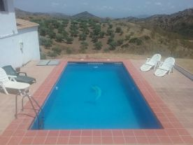 swimming pool and stunning views across mountains and olive groves