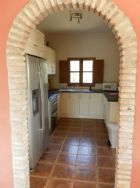 roman arch leading into kitchen