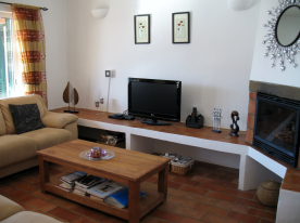 Spacious lounge with energy efficient wall heater. Central unit for alarm system.
