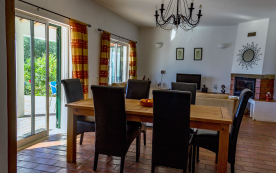 Spacious lounge/diner. Energy efficient wall heaters/wood burning fire. Patio doors to pool/garden.