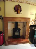 Kitchen fire surround, with fitted log burner 7.5kw, and solid oak surround