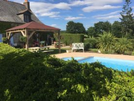 View from the vegetable gardens and lawned seating areas, looking over to the pool and pagoda
