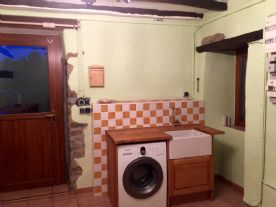 Laundry room, all recently renovated with bespoke solid oak units, made specifically for us!