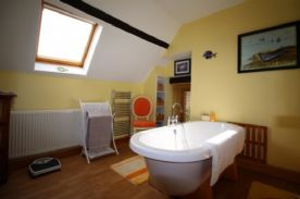 Bathroom, with large 2 person twin skinned bath on centre pedestal