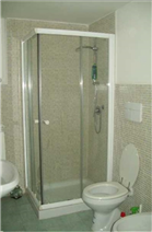 Large bathroom with box shower and Led lighting.