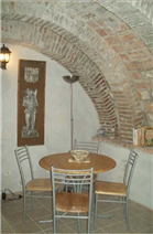 Beautiful stone-vaulted grotta for dining.