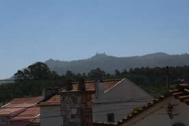 View from Annex Apt Balcony over rooftops to mountain and Pena Palace