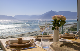 July Winter Sunshine in Kommetjie.Upstairs Dining Area towards Table Mountain