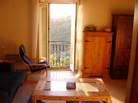 The main sitting room with its balcony and wide views.