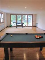 Lower ground floor games room with garden access.