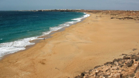 Surfer's Beach with El Cotillo in the background