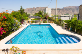 Gardens to rear of property, with pool, Bar-B-Q, fruit trees and mountain views