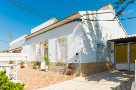 Frontal view of property, with traditional Spanish tiled patio