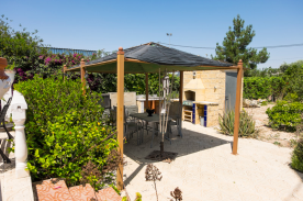Bar-B-Q and outdoor eating area to rear