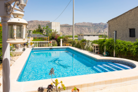 Full-sized pool with solar heated outdoor shower, bar-B-Q and mountain views