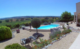 Terrace view to the west over pool and vines to the Pyrenees