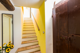frontdoor and stairs leading to guestrooms