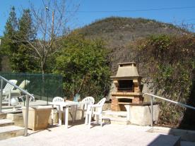 BBQ area alongside the pool